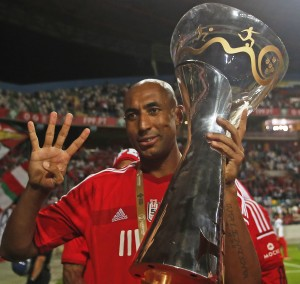 Benfica's Luisao celebrates with trophy after defeating Rio Ave in the Portuguese Super Cup at Aveiro's city stadium