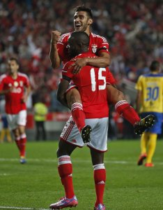 Benfica's Salvio celebrates his goal with teammate John during their Portuguese premier league soccer match against Arouca at Luz stadium in Lisbon